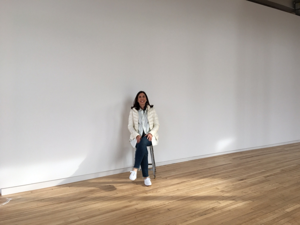 In front of the wall where the large watercolor will be on display